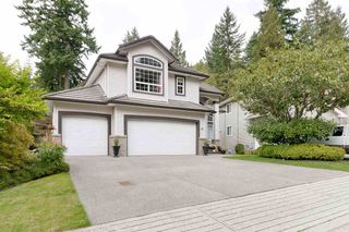 Photo 2: 35 FLAVELLE Drive in Port Moody: Barber Street House for sale : MLS®# R2513478
