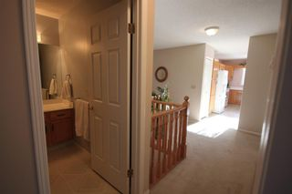Photo 19: 15 Coach Side Terrace SW in Calgary: Coach Hill Row/Townhouse for sale : MLS®# A1071978