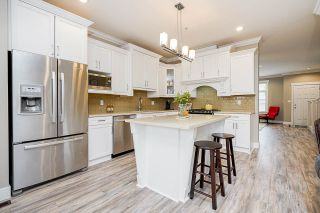 """Photo 10: 7793 211B Street in Langley: Willoughby Heights Condo for sale in """"SHAUGHNESSY MEWS"""" : MLS®# R2569575"""