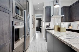 Photo 12: 230 Lucas Parade NW in Calgary: Livingston Detached for sale : MLS®# A1057760