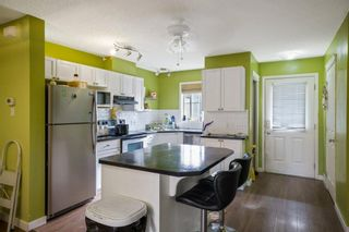 Photo 4: 102 140 Sagewood Boulevard SW: Airdrie Row/Townhouse for sale : MLS®# A1141135