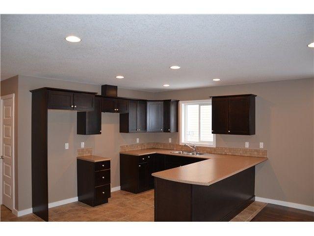 Photo 2: Photos: 9212 102 Avenue in Fort St. John: Fort St. John - City NE 1/2 Duplex for sale (Fort St. John (Zone 60))  : MLS®# N232123