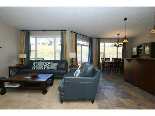 Photo 4: 188 SUNSET Close: Cochrane House for sale : MLS®# C4115906