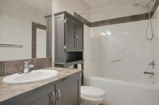 Photo 20: 48 Arbours Circle NW: Langdon Row/Townhouse for sale : MLS®# A1045296
