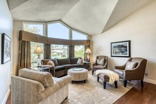 Photo 5: 555 Coach Light Bay SW in Calgary: Coach Hill Detached for sale : MLS®# A1144688