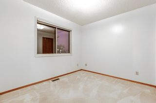 Photo 17: 10 Sandarac Circle NW in Calgary: Sandstone Valley Row/Townhouse for sale : MLS®# A1145487