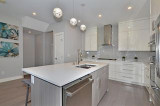 Photo 9: 154 21 Avenue NW in Calgary: Tuxedo Park Row/Townhouse for sale : MLS®# A1098746