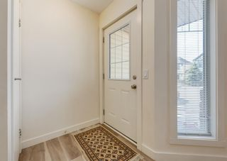 Photo 2: 402 2445 Kingsland Road SE: Airdrie Row/Townhouse for sale : MLS®# A1107683