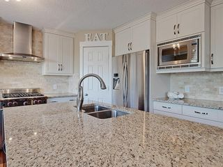 Photo 6: 54 BRIDLEPOST Green SW in Calgary: Bridlewood Detached for sale : MLS®# C4258811