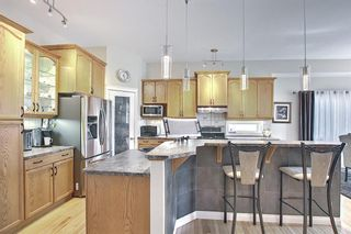 Photo 6: 31 Strathlea Common SW in Calgary: Strathcona Park Detached for sale : MLS®# A1147556