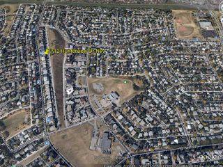 Photo 15: 7712 HUNTERVIEW Drive NW in CALGARY: Huntington Hills 4Plex for sale (Calgary)  : MLS®# C3630605