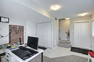 Photo 12: 111 Evanscrest Gardens NW in Calgary: Evanston Row/Townhouse for sale : MLS®# A1135885