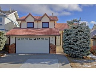 Photo 1: 71 Strathaven Circle SW in Calgary: Strathcona Park Detached for sale : MLS®# A1079924