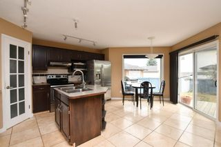 Photo 8: 93 ARBOUR RIDGE Park NW in Calgary: Arbour Lake Detached for sale : MLS®# A1026542