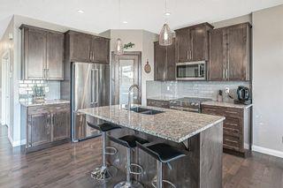 Photo 8: 203 Boulder Creek Bay SE: Langdon Detached for sale : MLS®# A1149788