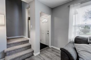 Photo 11: 341 Regal Park NE in Calgary: Renfrew Row/Townhouse for sale : MLS®# A1097610