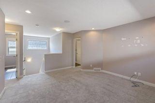 Photo 21: 144 Heritage Boulevard: Cochrane Detached for sale : MLS®# A1125296