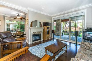 """Photo 2: 107 16447 64 Avenue in Surrey: Cloverdale BC Condo for sale in """"St. Andrews"""" (Cloverdale)  : MLS®# R2302117"""