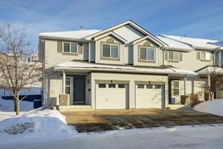 Main Photo: 169 Rocky Vista Circle NW in Calgary: Rocky Ridge Row/Townhouse for sale : MLS®# A1070825