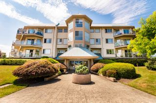 """Photo 1: 106 7685 AMBER Drive in Sardis: Sardis West Vedder Rd Condo for sale in """"The Sapphire"""" : MLS®# R2601700"""