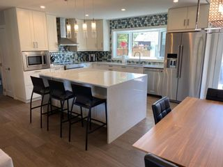 Photo 2: 419 Woodbend Road SE in Calgary: Willow Park Detached for sale : MLS®# A1075993