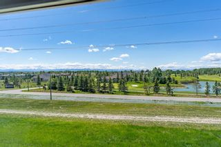 Photo 32: 119 Toscana Gardens NW in Calgary: Tuscany Row/Townhouse for sale : MLS®# A1121039