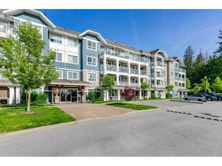 """Photo 2: 304 16396 64 Avenue in Surrey: Cloverdale BC Condo for sale in """"The Ridgse and Bose Farms"""" (Cloverdale)  : MLS®# R2579470"""
