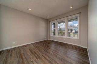 Photo 3: 8 HERITAGE Boulevard: Cochrane Detached for sale : MLS®# C4203081