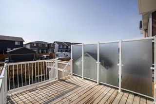 Photo 30: 122 Sunset Road: Cochrane Row/Townhouse for sale : MLS®# A1127717