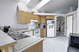Photo 5: 37 Everstone Avenue SW in Calgary: Evergreen Detached for sale : MLS®# A1102221