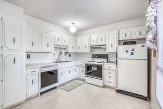Photo 7: 53 9908 Bonaventure Drive SE in Calgary: Willow Park Row/Townhouse for sale : MLS®# A1104904