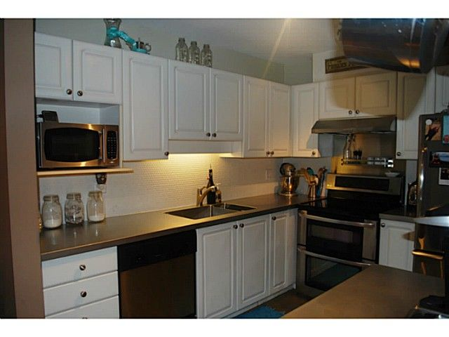 Main Photo: 313 2558 Parkview Ln in Port Coquitlam: Central Pt Coquitlam Condo for sale : MLS®# V1101255