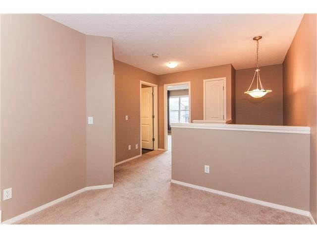 Photo 15: Photos: 136 EVERSYDE Boulevard SW in Calgary: Evergreen House for sale : MLS®# C4081553