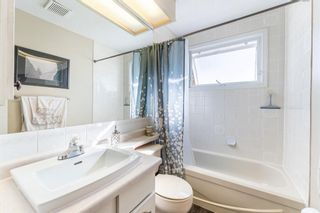 Photo 8: 6128 Longmoor Way SW in Calgary: Lakeview Detached for sale : MLS®# A1150514