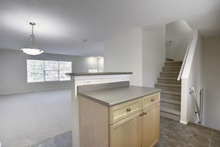 Photo 17: 25 Tuscany Springs Gardens NW in Calgary: Tuscany Row/Townhouse for sale : MLS®# A1053153