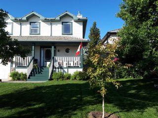 Photo 1: 21 Bow Ridge Crescent: Cochrane Detached for sale : MLS®# A1079980