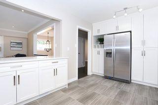 """Photo 9: 7159 116 Street in Delta: Sunshine Hills Woods House for sale in """"Sunshine Hills"""" (N. Delta)  : MLS®# R2105626"""