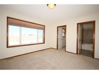 Photo 24: 103 WEST POINTE Court: Cochrane House for sale : MLS®# C4042878