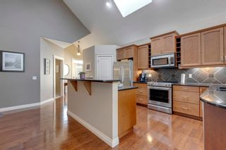 Photo 10: 84 Cimarron Estates Green: Okotoks Semi Detached for sale : MLS®# A1149803