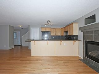 Photo 14: 89 SUNSET Heights: Cochrane House for sale : MLS®# C4177018