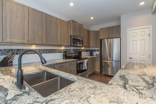 Photo 10: 124 Kingsmere Cove SE: Airdrie Detached for sale : MLS®# A1115152