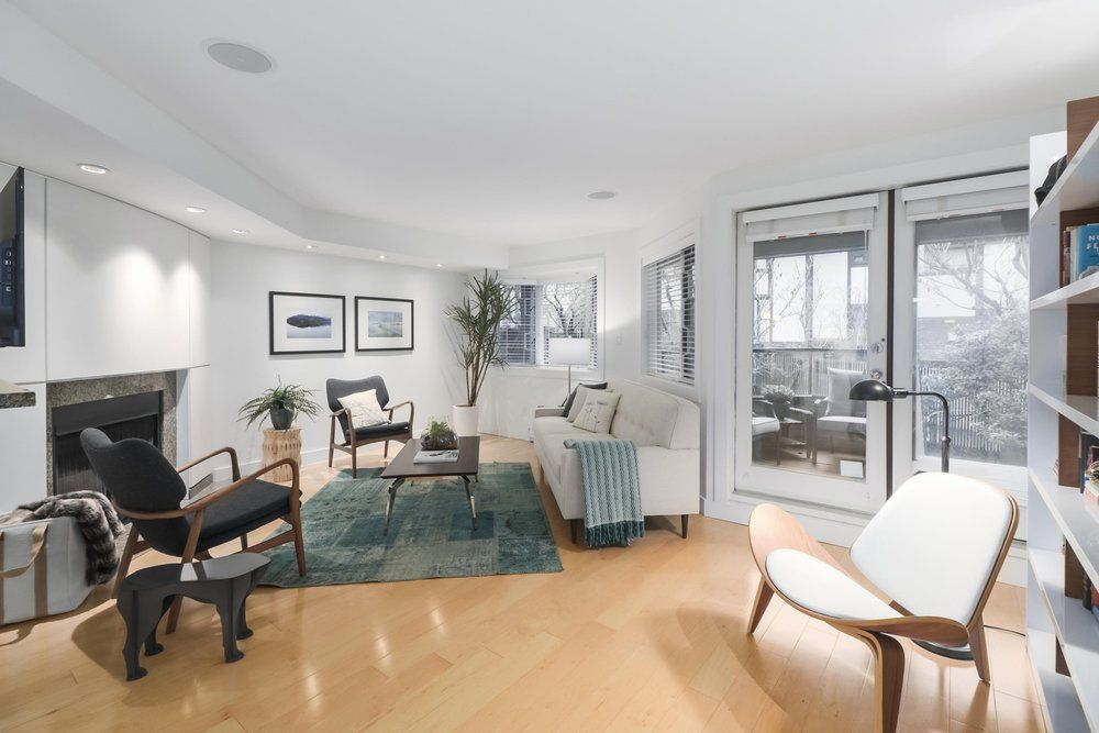 """Main Photo: 2411 W 1ST Avenue in Vancouver: Kitsilano Townhouse for sale in """"BAYSIDE MANOR"""" (Vancouver West)  : MLS®# R2408792"""