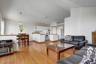 Photo 9: 26 HIDDEN RANCH Road NW in Calgary: Hidden Valley House for sale