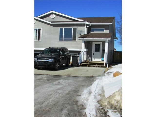 """Main Photo: 7916 97TH Avenue in Fort St. John: Fort St. John - City SE 1/2 Duplex for sale in """"NORTH ANNEOFIELD"""" (Fort St. John (Zone 60))  : MLS®# N234446"""