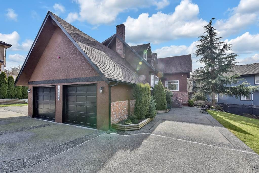 Main Photo: 15412 80 Avenue in Surrey: Fleetwood Tynehead House for sale : MLS®# R2544551
