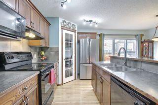 Photo 7: 507 CRANSTON Drive SE in Calgary: Cranston Semi Detached for sale : MLS®# A1096258
