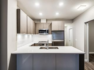 Photo 2: 216 823 5 Avenue NW in Calgary: Sunnyside Apartment for sale : MLS®# A1127836