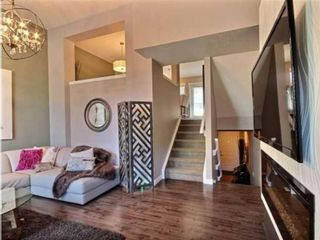 Photo 3: 2 1302 Russell Road NE in Calgary: Renfrew Row/Townhouse for sale : MLS®# A1146794