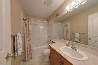 Photo 19: 38 1008 Woodside Way NW: Airdrie Row/Townhouse for sale : MLS®# A1123458