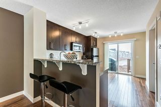 Photo 6: 1562 93 Street SW in Calgary: Aspen Woods Row/Townhouse for sale : MLS®# A1085332